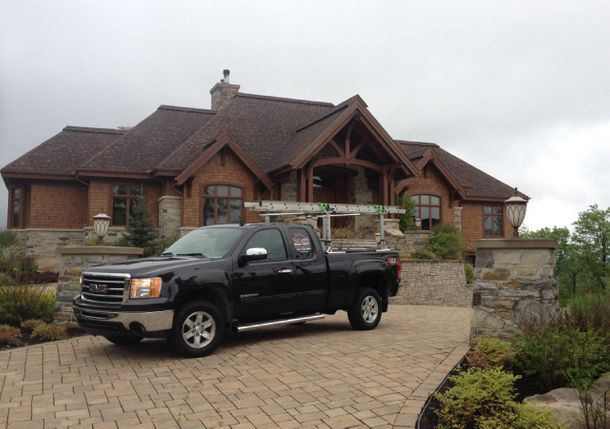 Beautiful residence with black pickup truck parked in front